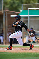GCL Marlins catcher Luis Arcaya (11) hits a two run single during a game against the GCL Cardinals on August 4, 2018 at Roger Dean Chevrolet Stadium in Jupiter, Florida.  GCL Marlins defeated GCL Cardinals 6-3.  (Mike Janes/Four Seam Images)