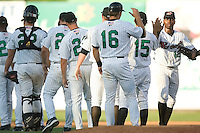 The Winston-Salem Warthogs line up to congratulate each other after defeating the Frederick Keys 1-0 in the first game of a double header at Ernie Shore Field in Winston-Salem, NC, Thursday, June 15, 2006.