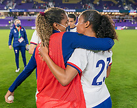 ORLANDO, FL - JANUARY 22: Catarina Macario #29 of the USWNT hugs Margaret Purce #23 after a game between Colombia and USWNT at Exploria stadium on January 22, 2021 in Orlando, Florida.