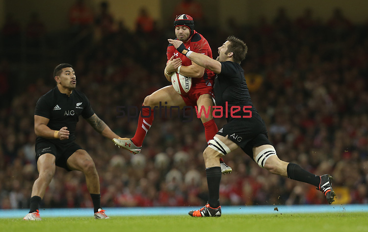 Wales fullback Leigh Halfpenny takes the high ball under pressure from All Blacks captain Richie McCaw and wing Charles Piutau.<br /> Dove men Series 2014<br /> Wales v New Zealand<br /> 22.11.14<br /> ©Steve Pope -SPORTINGWALES