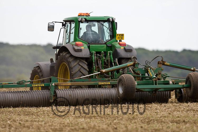 John Deere tractor rolling a field after drilling.©Tim Scrivener,Vine Cottage,Barholm,Stamford,.Lincolnshire,PE9 4RA.