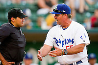 Ogden Raptors manager Damon Berryhill (55) argues a call with home plate umpire Charlie Ramos during the Pioneer League game against the Orem Owlz at Lindquist Field on July 28, 2012 in Ogden, Utah.  The Raptors defeated the Owlz 8-7.   (Brian Westerholt/Four Seam Images)