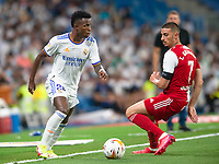 12th September 2021; Estadio Santiago Bernabeu, Madrid, Spain; La Liga, Real Madrid CF versus RC Celta de Vigo; Vinicius of Real Madrid takes on Thiago Galhardo of Celta de Vigo