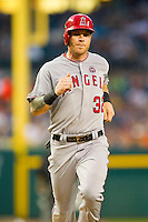 Josh Hamilton (32) of the Los Angeles Angels hustles down the third base line on his way to scoring a run against the Detroit Tigers at Comerica Park on June 25, 2013 in Detroit, Michigan.  The Angels defeated the Tigers 14-8.  (Brian Westerholt/Four Seam Images)