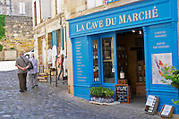 Wine shop. La Cave du March with a senior couple walking past. The town. Saint Emilion, Bordeaux, France