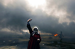 A Palestinian woman takes a selfie during clashes with Israeli security forces in tents protest where Palestinians demanding the right to return to their homeland, at the Israel-Gaza border, in Khan Younis in the southern Gaza Strip, on May 4, 2018. Photo by Yasser Qudih