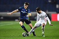 Marten De Roon of Atalanta BC and Nacho Fernandez of Real Madrid compete for the ball during the Champions League round of 16 football match between Atalanta BC and Real Madrid at Atleti azzurri d'Italia stadium in Bergamo (Italy), February, 24th, 2021. Photo Image Sport  / Insidefoto