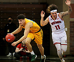 SIOUX FALLS, SD - MARCH 8: Jarius Cook #11 of the North Dakota State Bison steals the ball from Mason Archambault #11 of the South Dakota Coyotes during the Summit League Basketball Tournament at the Sanford Pentagon in Sioux Falls, SD. (Photo by Dave Eggen/Inertia)