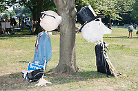 A Bernie Sanders puppet rests against a tree in the protest area in FDR Park  outside of the secure area surrounding the Democratic National Convention at the Wells Fargo Center in Philadelphia, Pennsylvania, on Wed., July 27, 2016.