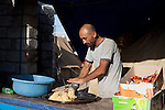 DOMIZ, IRAQ: A chef makes falafel in the Domiz refugee camp...Over 7,000 Syrian Kurds have fled the violence in Syria and are living in the Domiz refugee camp in the semi-autonomous region of Iraqi Kurdistan...Photo by Ali Arkady/Metrography