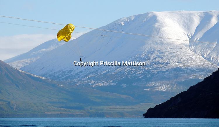 Queenstown, New Zealand - September 12, 2012:  A parasailer soars over Lake Wakatipu.
