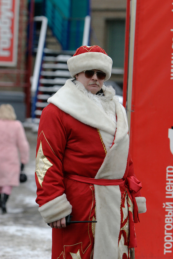 Moscow, Russia, 03/01/2004..A secutrity guard dressed as Father Christmas outside the complex which houses the El Dorado electronics store.