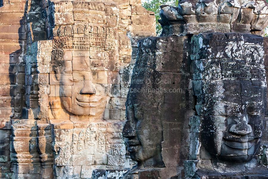 Cambodia, Bayon Temple.  Three Smiling Buddha Faces.