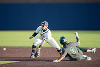 Michigan Wolverines second baseman Riley Bertram (12) waits for a throw as Michigan State baserunner Zaid Walker (3) slides into second on March 21, 2021 in NCAA baseball action at Ray Fisher Stadium in Ann Arbor, Michigan. Michigan scored 8 runs in the bottom of the ninth inning to defeat the Spartans 8-7. (Andrew Woolley/Four Seam Images)