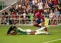 AUSTIN, TX - JUNE 16: Michelle Alozie #22 of Nigeria defends Crystal Dunn #19 of the USWNT during a game between Nigeria and USWNT at Q2 Stadium on June 16, 2021 in Austin, Texas.