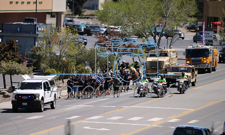 Carson City Sheriff's and other law enforcement representatives run the memorial baton into downtown Carson City, Nev., on Wednesday, May 3, 2017. The 20th annual Nevada Law Enforcement Memorial ceremony will be tomorrow.<br />