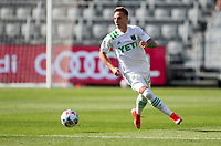 LOS ANGELES, CA - APRIL 17: Žan Kolmanič #21 of Austin FC looking for an open teammate during a game between Austin FC and Los Angeles FC at Banc of California Stadium on April 17, 2021 in Los Angeles, California.