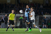 Sam Wood of Wycombe Wanderers controls the ball under pressure from Tom Cairney of Fulham during the Capital One Cup match between Wycombe Wanderers and Fulham at Adams Park, High Wycombe, England on 11 August 2015. Photo by Andy Rowland.