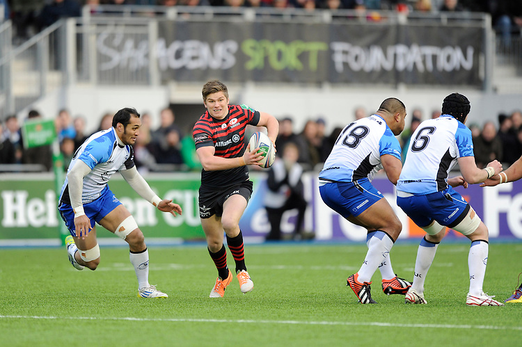 Owen Farrell of Saracens spots a gap in the Connacht defence during the Heineken Cup Round 6 match between Saracens and Connacht Rugby at Allianz Park on Saturday 18th January 2014 (Photo by Rob Munro)