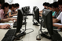 Students using computers in a classroom at a private education school.