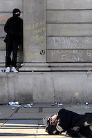 A demonstrator sleeps outside the Bank of England as thousands of protestors descended on the City of London ahead of the G20 summit of world leaders to express anger at the economic crisis, which many blame on the excesses of capitalism.