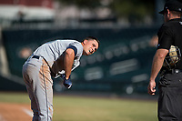 Peoria Javelinas first baseman Evan White (15), of the Seattle Mariners organization, questions a strike three call from home plate umpire Bryan Fields during an Arizona Fall League game against the Mesa Solar Sox at Sloan Park on October 24, 2018 in Mesa, Arizona. Mesa defeated Peoria 4-3. (Zachary Lucy/Four Seam Images)