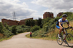 The Lea valley Eastway cycle circuit in background the Clays Lane housing and tower block development. East London regeneration area for the 2012 Olympic Games park village and arena. London 2006.