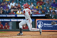 Heston Kjerstad (18) of the Arkansas Razorbacks follows through on his swing against the Oklahoma Sooners in game two of the 2020 Shriners Hospitals for Children College Classic at Minute Maid Park on February 28, 2020 in Houston, Texas. The Sooners defeated the Razorbacks 6-3. (Brian Westerholt/Four Seam Images)