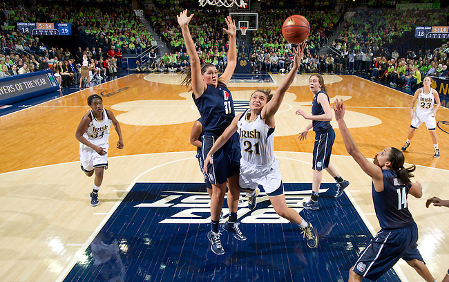 Mar 4, 2013; Kayla McBride (21) goes up for a shot in the first half against UConn. Notre Dame won 96-87 in triple overtime. ..Photo by Matt Cashore/University of Notre Dame