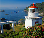 Humbolt County, CA<br /> Morning sun on the Trinidad Memorial Lighthouse & harbor boats on the north California coast