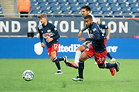 FOXBOROUGH, MA - APRIL 17: Christian Malfa #38 of New England Revolution II and Zaca Moran #6 of Richmond Kickers chase down the ball in midfield during a game between Richmond Kickers and Revolution II at Gillette Stadium on April 17, 2021 in Foxborough, Massachusetts.