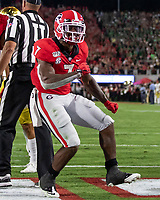ATHENS, GA - SEPTEMBER 21: D'Andre Swift #7 of the Georgia Bulldogs celebrates after scoring a touchdown during a game between Notre Dame Fighting Irish and University of Georgia Bulldogs at Sanford Stadium on September 21, 2019 in Athens, Georgia.