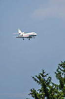 8 July 2014: A Dassault Falcon 900 comes in for a landing during a minor league baseball game between the Lowell Spinners and the Vermont Lake Monsters at Centennial Field in Burlington, Vermont. The Lake Monsters rallied in the 9th inning to defeat the Spinners 5-4 in NY Penn League action. Mandatory Credit: Ed Wolfstein Photo *** RAW Image File Available ****