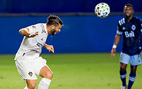 CARSON, CA - OCTOBER 18: Emiliano Insua #3 of the Los Angeles Galaxy heads a ball during a game between Vancouver Whitecaps and Los Angeles Galaxy at Dignity Heath Sports Park on October 18, 2020 in Carson, California.