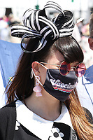 30th April 2021; Kentucky, USA;  Spectators wears a mask with Vaccinated written on it during Oaks Day on April 30, 2021 at Churchill Downs in Louisville, Kentucky.