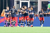 FOXBOROUGH, MA - MAY 22: New England Revolution celebrate their second goal against New York Red Bulls during a game between New York Red Bulls and New England Revolution at Gillette Stadium on May 22, 2021 in Foxborough, Massachusetts.