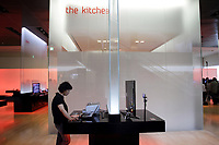 SOUTH KOREA. A customer uses a computer inside the main showroom of Samsung, at their head-office in downtown Seoul. 2010