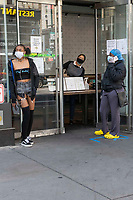 New York, New York City, during the time of the Coronavirus. Girl waiting to pick up her food order at Shake Shack, now open only for pick up and delivery.