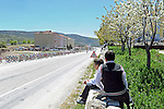 Locals boys watch as the peloton passes by during Stage 5 of the 2015 Presidential Tour of Turkey running 159.9km from Mugla to Pamukkale. 30th April 2015.<br /> Photo: Tour of Turkey/Mario Stiehl/www.newsfile.ie
