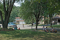 A quiet afternoon on a cul-de-sac watching kids and their parents play.  Photo Copyright Gary Gardiner. Not be used without written permission detailing exact usage.