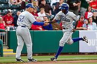 Hector Gomez (5) of the Tulsa Drillers shakes hands with Manager Duane Espy (52) after hitting a home run in the first inning during a game against the Springfield Cardinals on April 29, 2011 at Hammons Field in Springfield, Missouri.  Photo By David Welker/Four Seam Images.