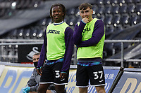 (L-R) Tivonge Rushesha and Daniel Williams of Swansea City stand to watch the giant screen during the Sky Bet Championship between Swansea City and Rotherham at the Liberty Stadium, Swansea, Wales, UK. Saturday 21 November 2020
