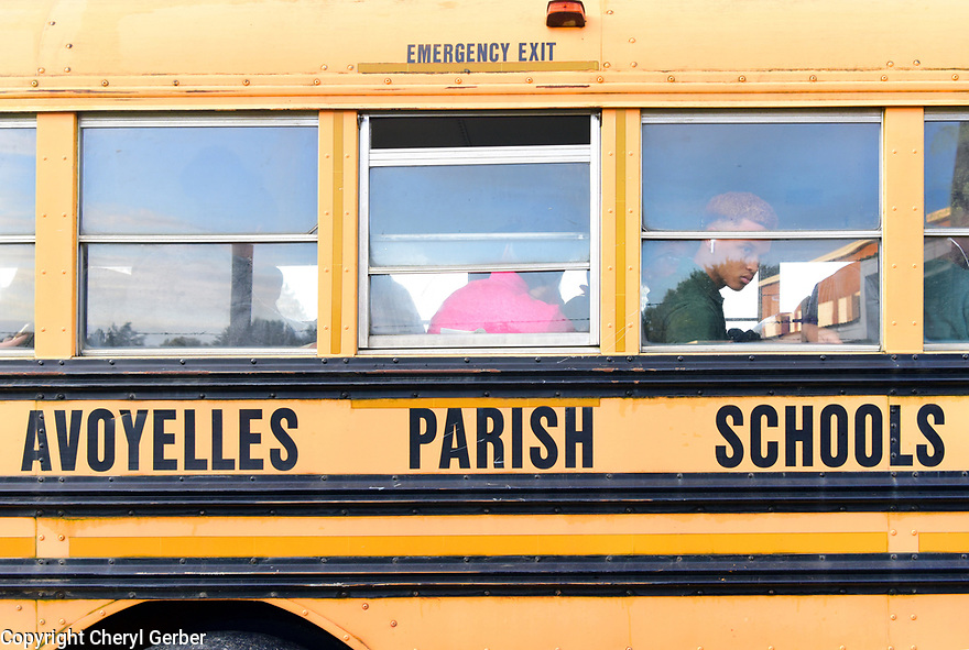 Buses arrive at 7 a.m. at Marksville High School in Marksville, La., Sept. 18, 2017.