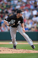Chicago White Sox starting pitcher John Danks (50) follows through on his delivery against the Charlotte Knights at BB&T Ballpark on April 3, 2015 in Charlotte, North Carolina.  The Knights defeated the White Sox 10-2.  (Brian Westerholt/Four Seam Images)