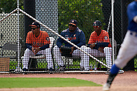 GCL Astros coach Rene Rojas (4), pitching coach Jose Rada, and manager Wladimir Sutil (11) during a Gulf Coast League game against the GCL Mets on August 10, 2019 at FITTEAM Ballpark of the Palm Beaches Training Complex in Palm Beach, Florida.  GCL Astros defeated the GCL Mets 8-6.  (Mike Janes/Four Seam Images)