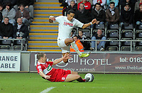 ATTENTION SPORTS PICTURE DESK<br /> Pictured: Scott Sinclair of Swansea (TOP) is tackled by Tony McMahon of Middlesbrough<br /> Re: npower Championship, Swansea City FC v Middlesbrough Football Club at the Liberty Stadium, south Wales. Sunday 14 November 2010