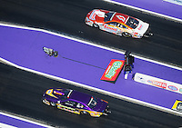 Apr. 28, 2012; Baytown, TX, USA: Aerial view of NHRA pro stock driver Vincent Nobile (bottom) races alongside Jason Line during qualifying for the Spring Nationals at Royal Purple Raceway. Mandatory Credit: Mark J. Rebilas-