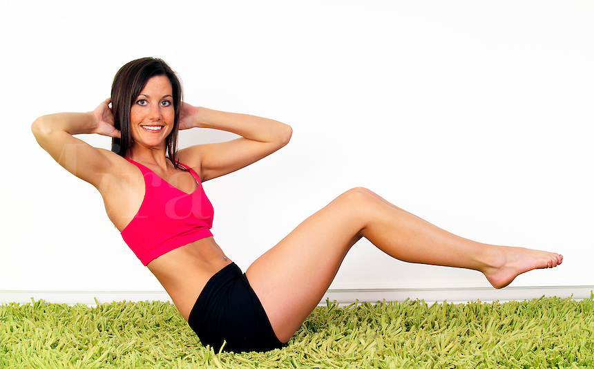 Beautiful brunette stretching and doing yoga