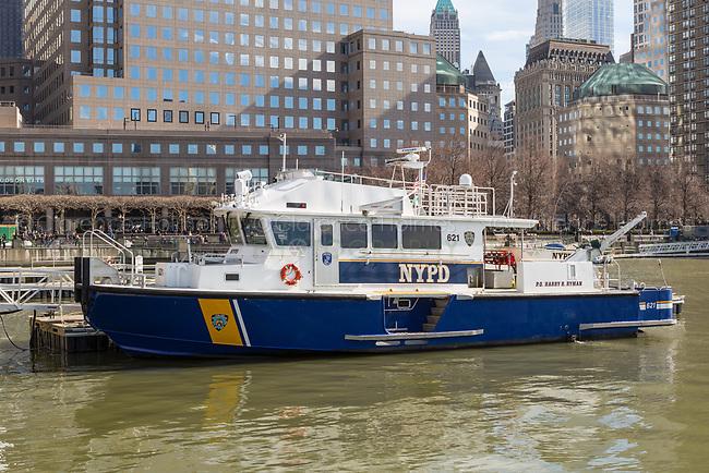 "NYPD harbor patrol boat ""P.O. Harry R. Ryman"" anchored at the North Cove Marina at Brookfield Place in New York City."