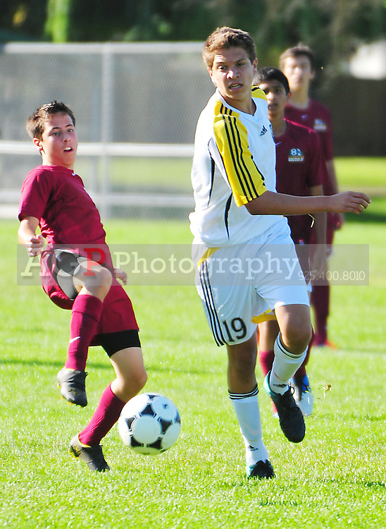 BUSC U16 Advance battle their opponent  in Pleasanton, California.  (Photo by Alan Greth/AGP Photography).